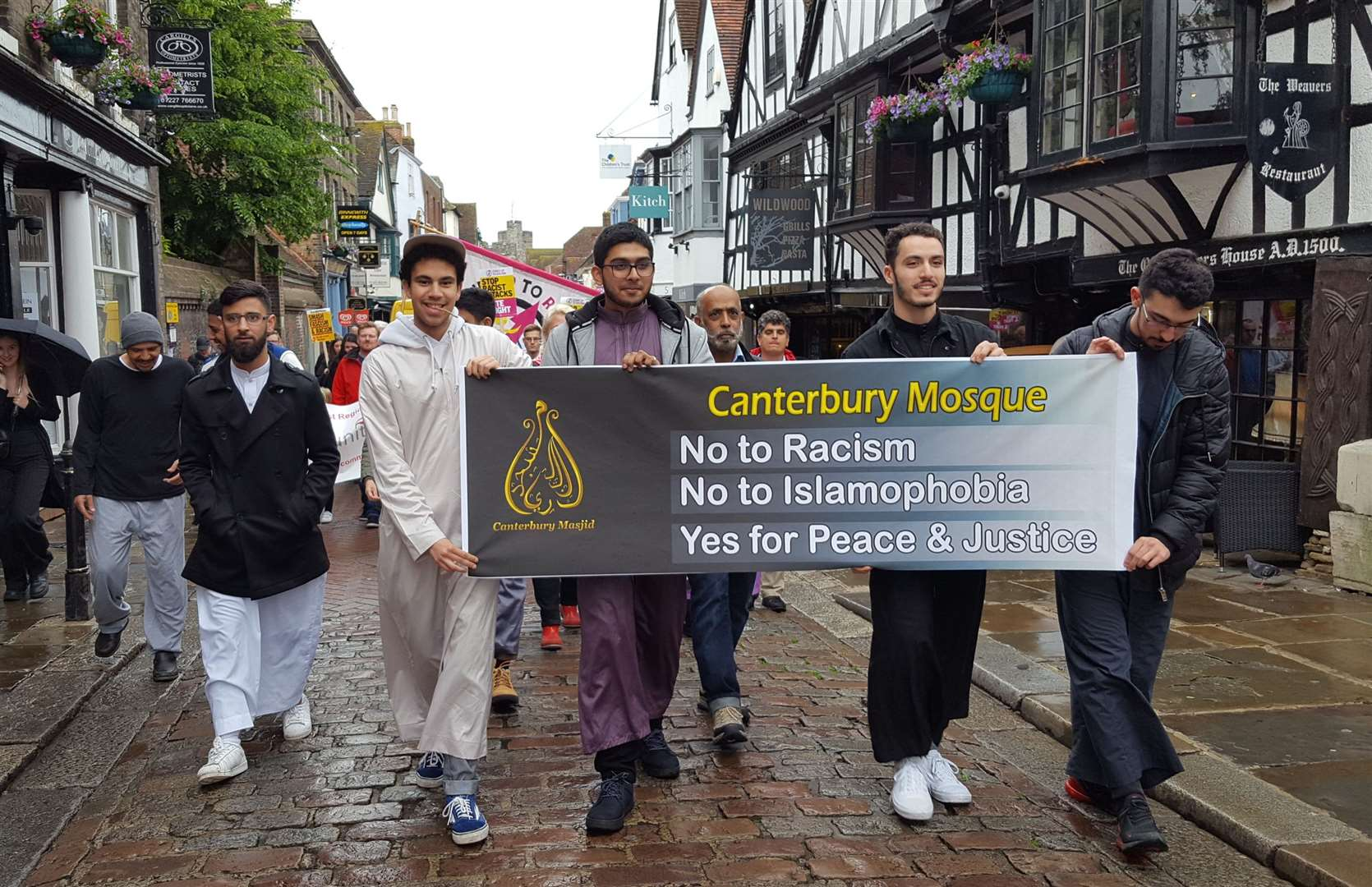 Representatives from Canterbury Mosque march along the high street