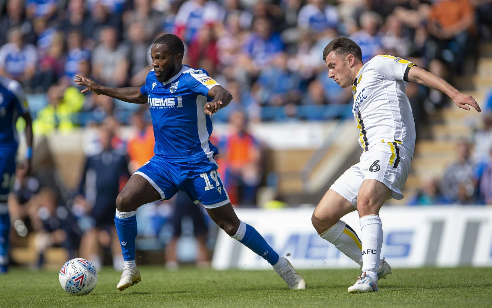 Gillingham's Mark Marshall gets away from Kieran Wallace Picture: Ady Kerry