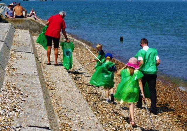 Litter pickers searching for rubbish at Sheerness beach. Stock image. Picture: Lee Pearce