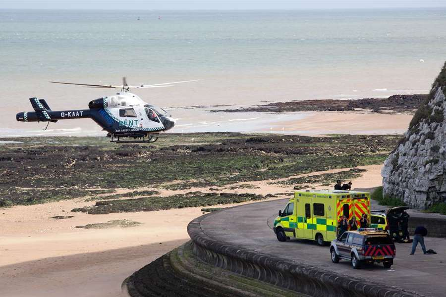 The air ambulance lands at the spot where Joshua Brown fell in Louisa Bay. Picture: James Rene Weatherley