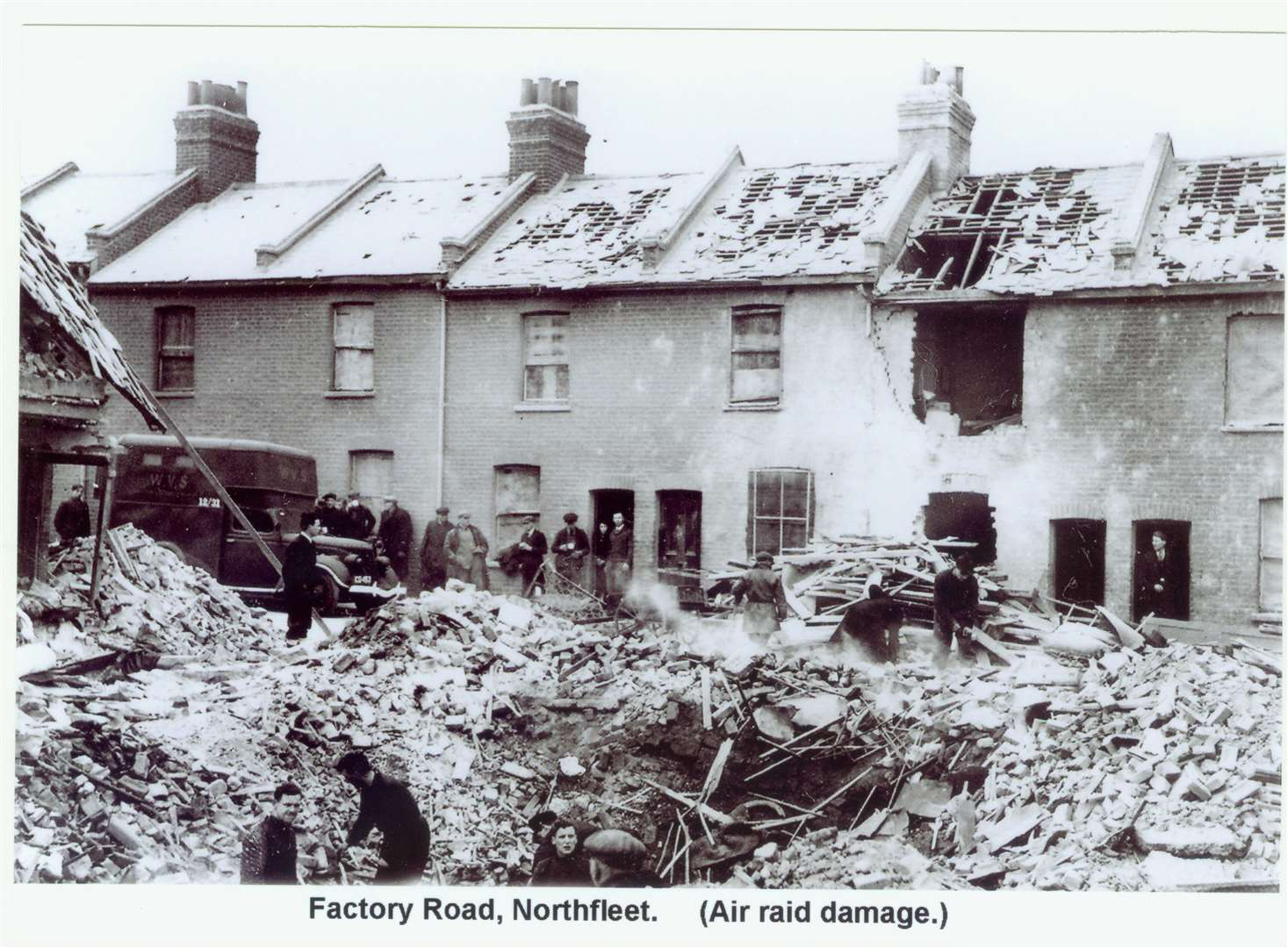 "Factory Road, Northfleet after an air raid during the war. In the doorway on the very left stands Fanny Harden, mother of war hero Henry ""Eric"" Harden. Picture: Gravesend Library (6705054)"