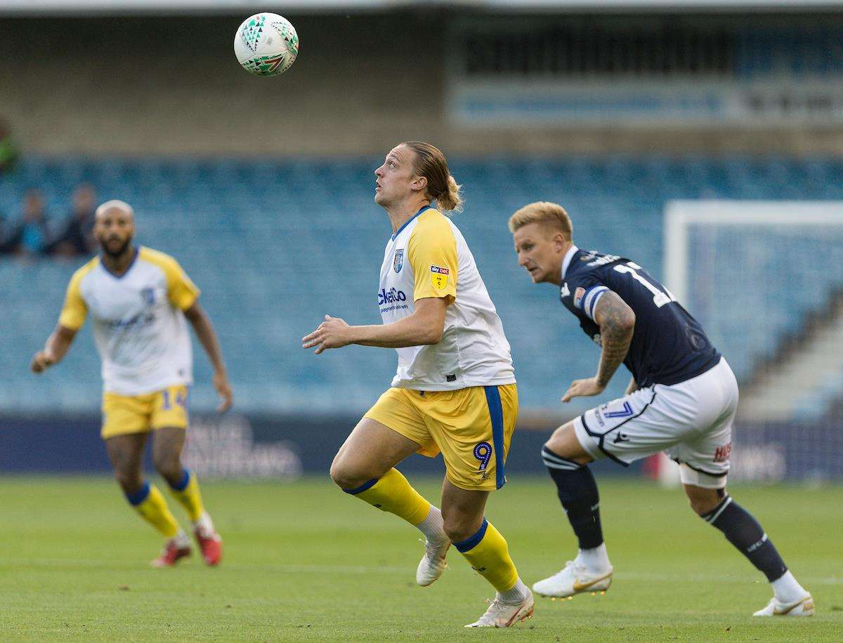 Tom Eaves gets away from Millwall's Byron Webster Picture: Ady Kerry (3603221)