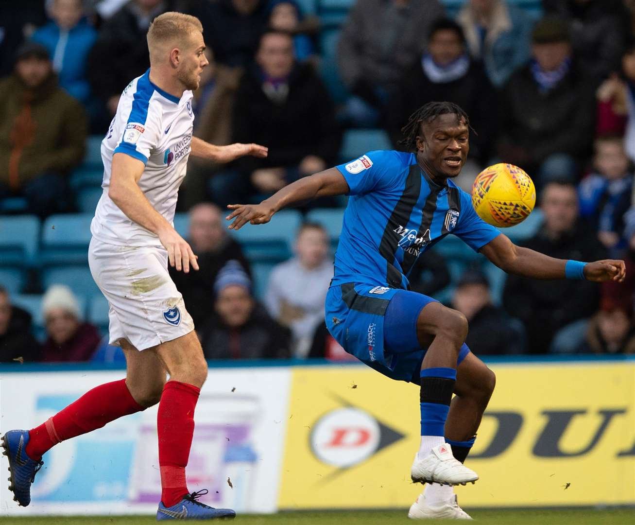 Gillingham debutant Noel Mbo looks to get the ball under control against Jack Whatmough. Picture: Ady Kerry