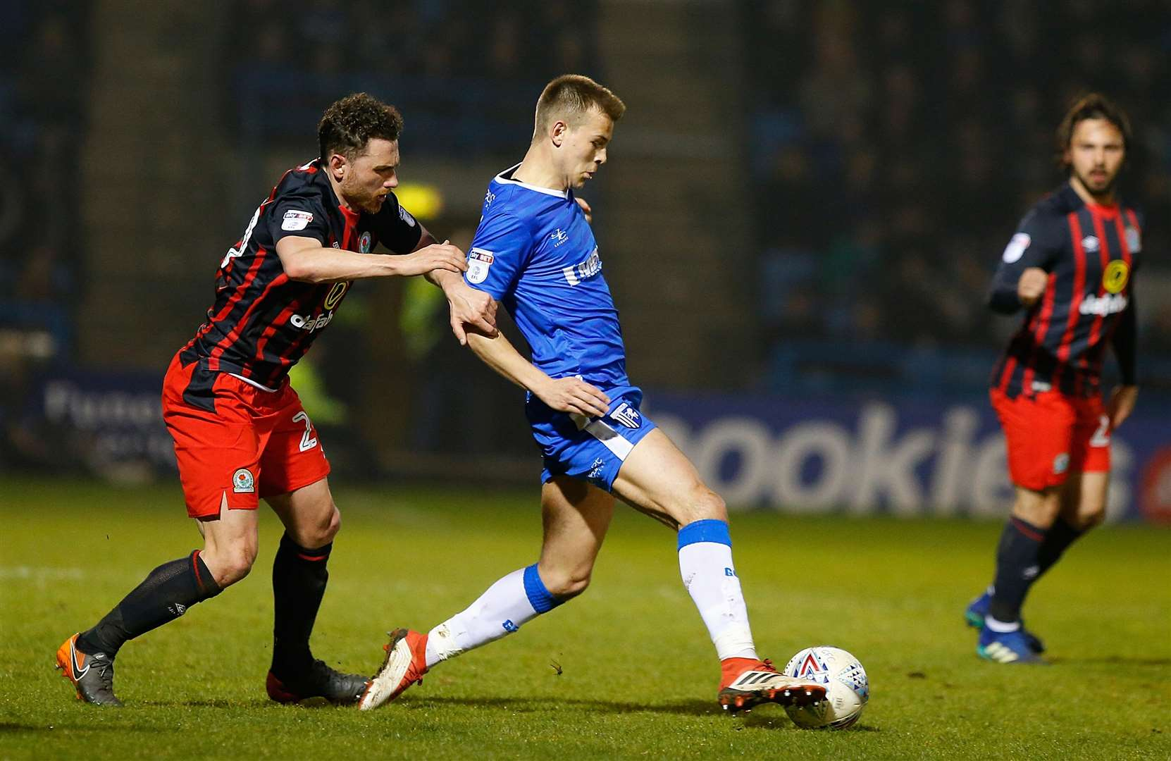 Jake Hessenthaler under pressure from Blackburn Rovers' Corry Evans Picture: Andy Jones