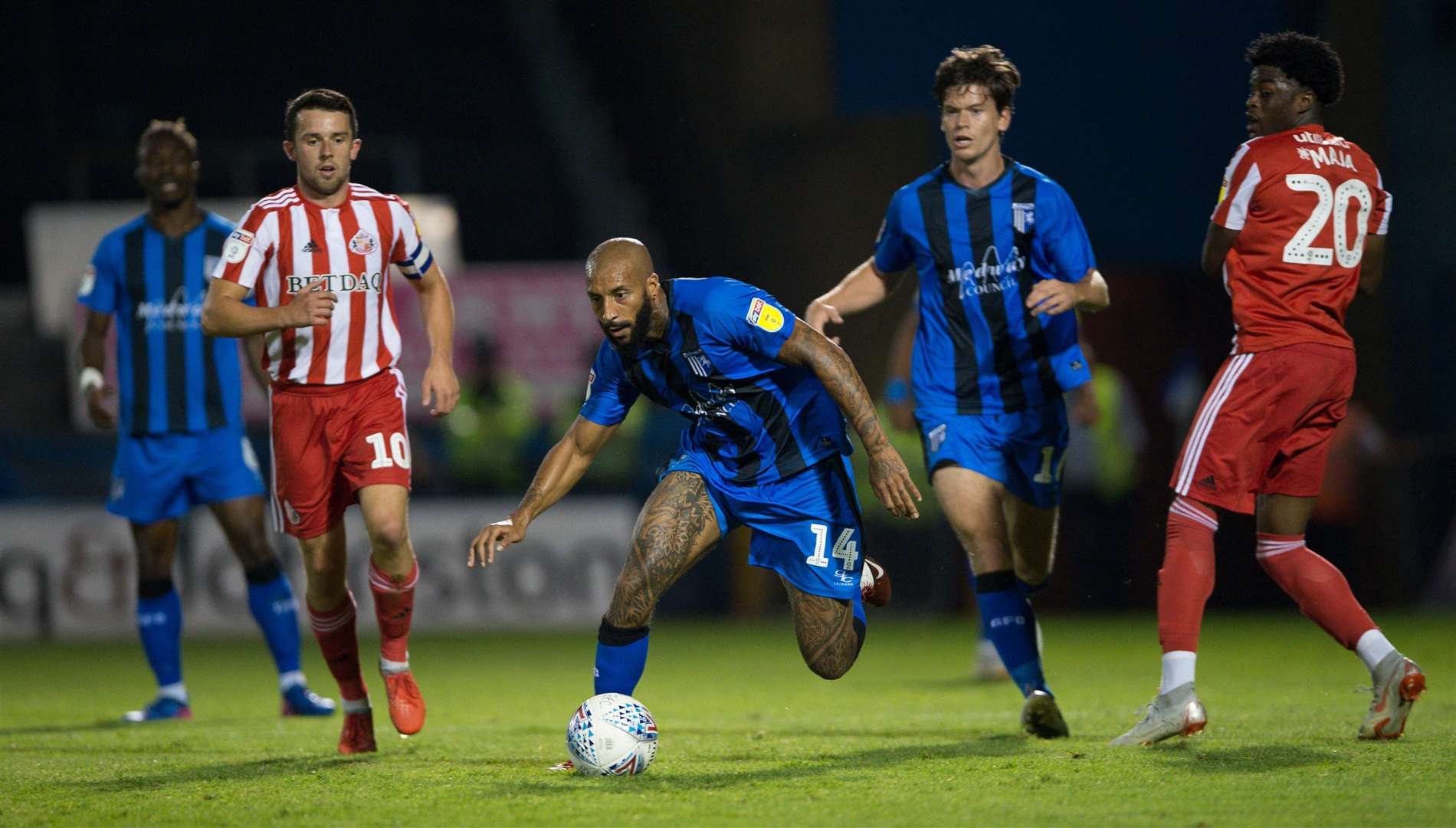 Gillingham's Josh Parker gets away from Josh Maja. Picture: Ady Kerry