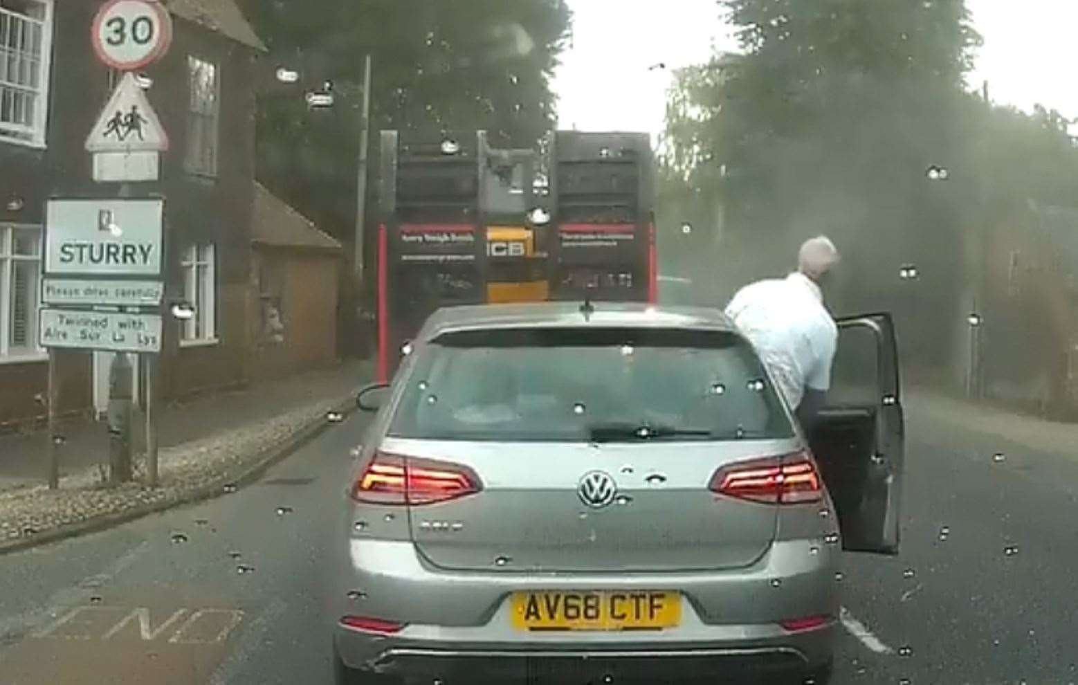 A driver leans out of his car to get a closer look. Pic: AngryBritain / Twitter (13676604)
