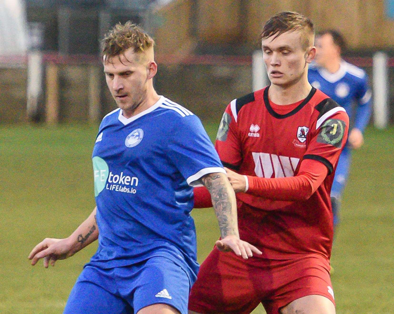 Hythe Town midfielder Danny Walder (blue shirt) Picture: Alan Langley