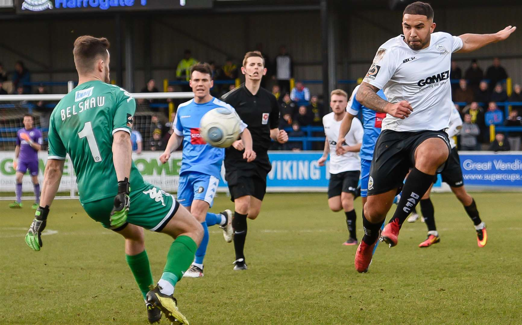 Dover midfielder Jai Reason is denied by Harrogate keeper James Belshaw Picture: Alan Langley