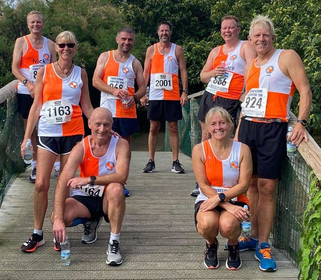 South Kent Harriers at the Folkestone coastal 10K. From left: Nick Hilditch, Jane Wren, Alan Randall (sitting), Kevin Southen, Lee Sentenacq, Craig Hoveman, Helen Proud(sitting) and Andy Fogg.