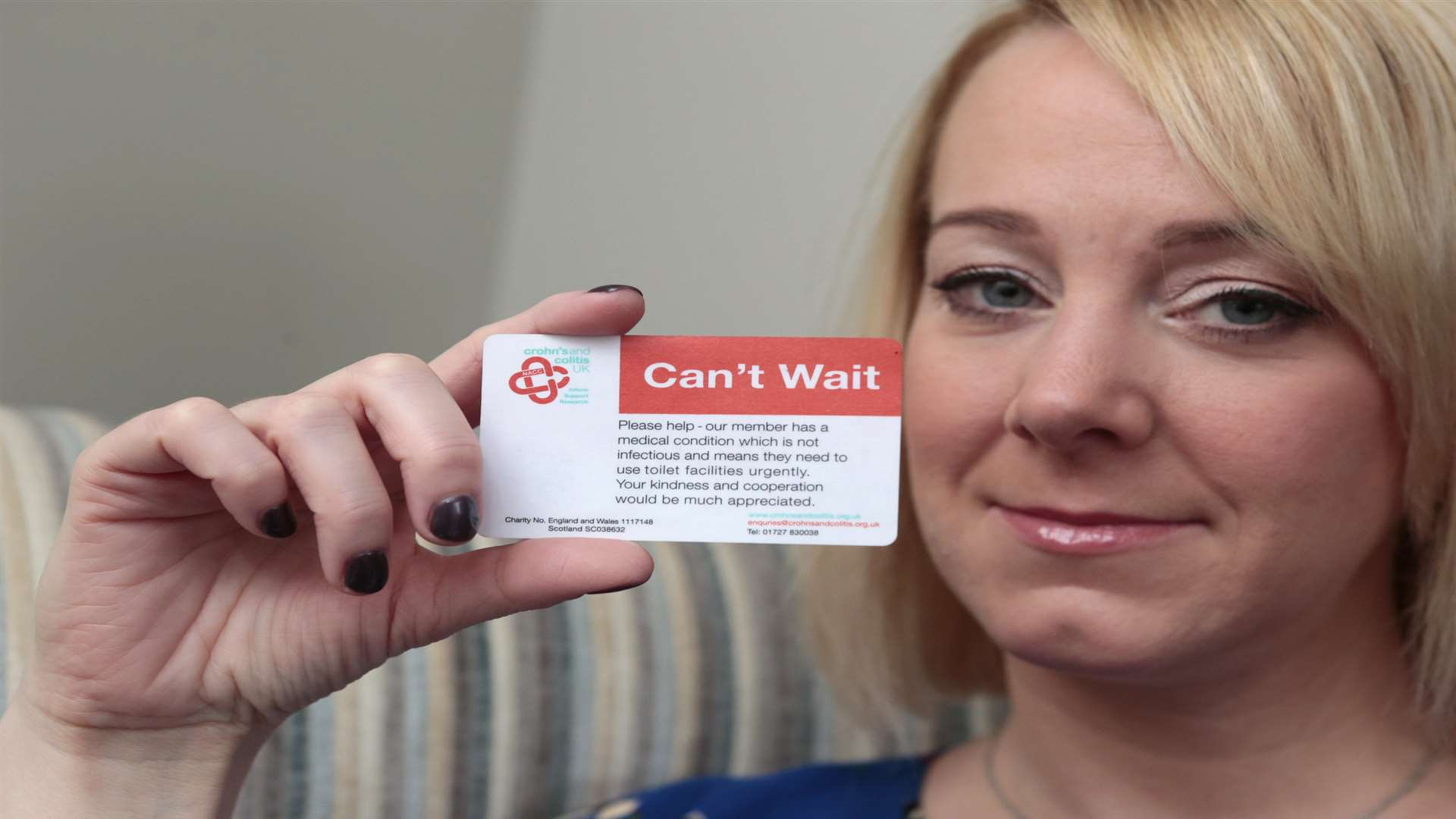 Lucy Barber, showing her NHS card. Picture: Martin Apps
