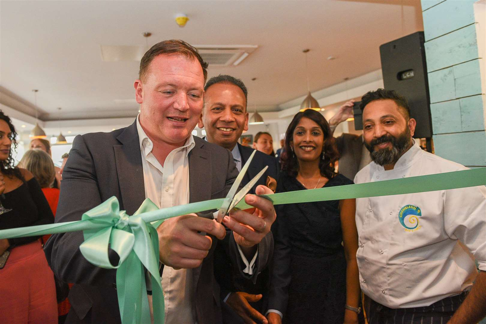 MP Damian Collins cuts the ribbon at the official opening