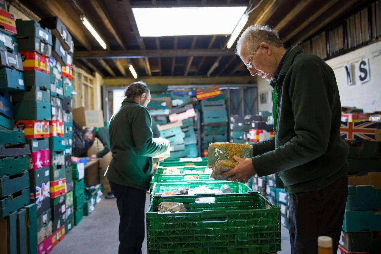 Volunteers unload supplies at a Trussell Trust foodbank