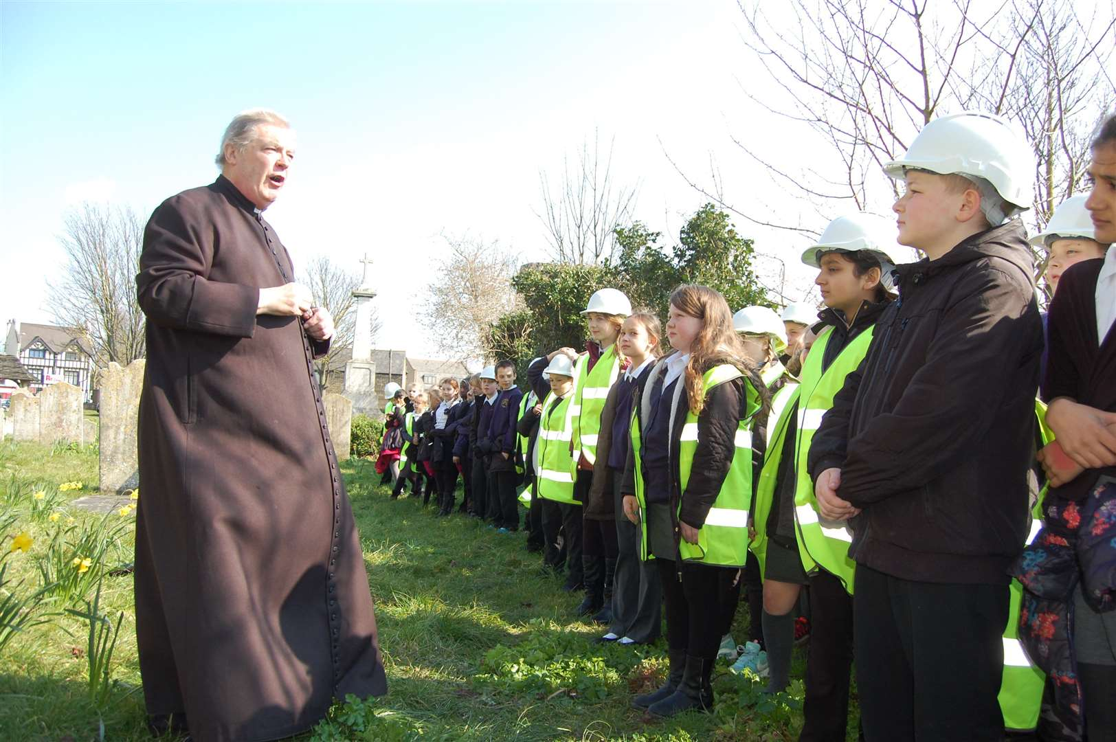 Vicar Laurence Smith addresses pupils from Lawn Primary School outside St Botolph's Church in Northfleet.