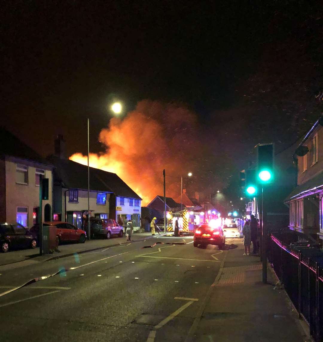 Flames burst through the roof of FJ Williams joinery in London Road, Teynham. Picture: Paul Mercer (5309072)