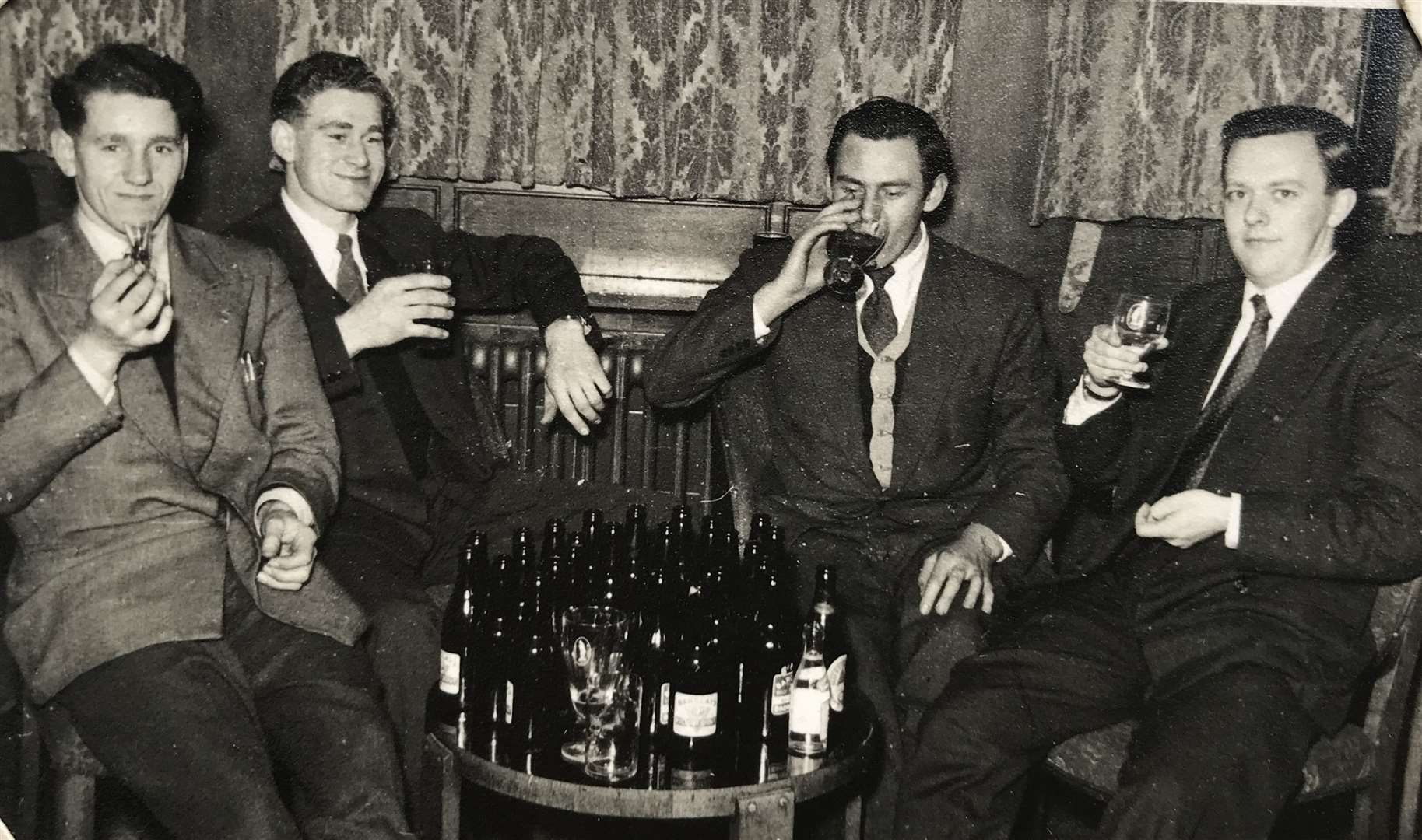 Peter Newman on the right relaxing with pals, his chum Mike is two along from him