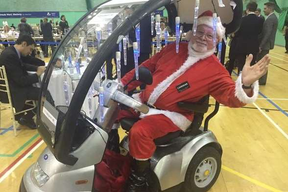 Independent Mike Barber turns up to the count in a Santa suit & electric buggy decked out in lights