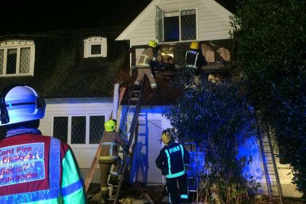 Firefighters tackle the blaze at Rowhill Grange