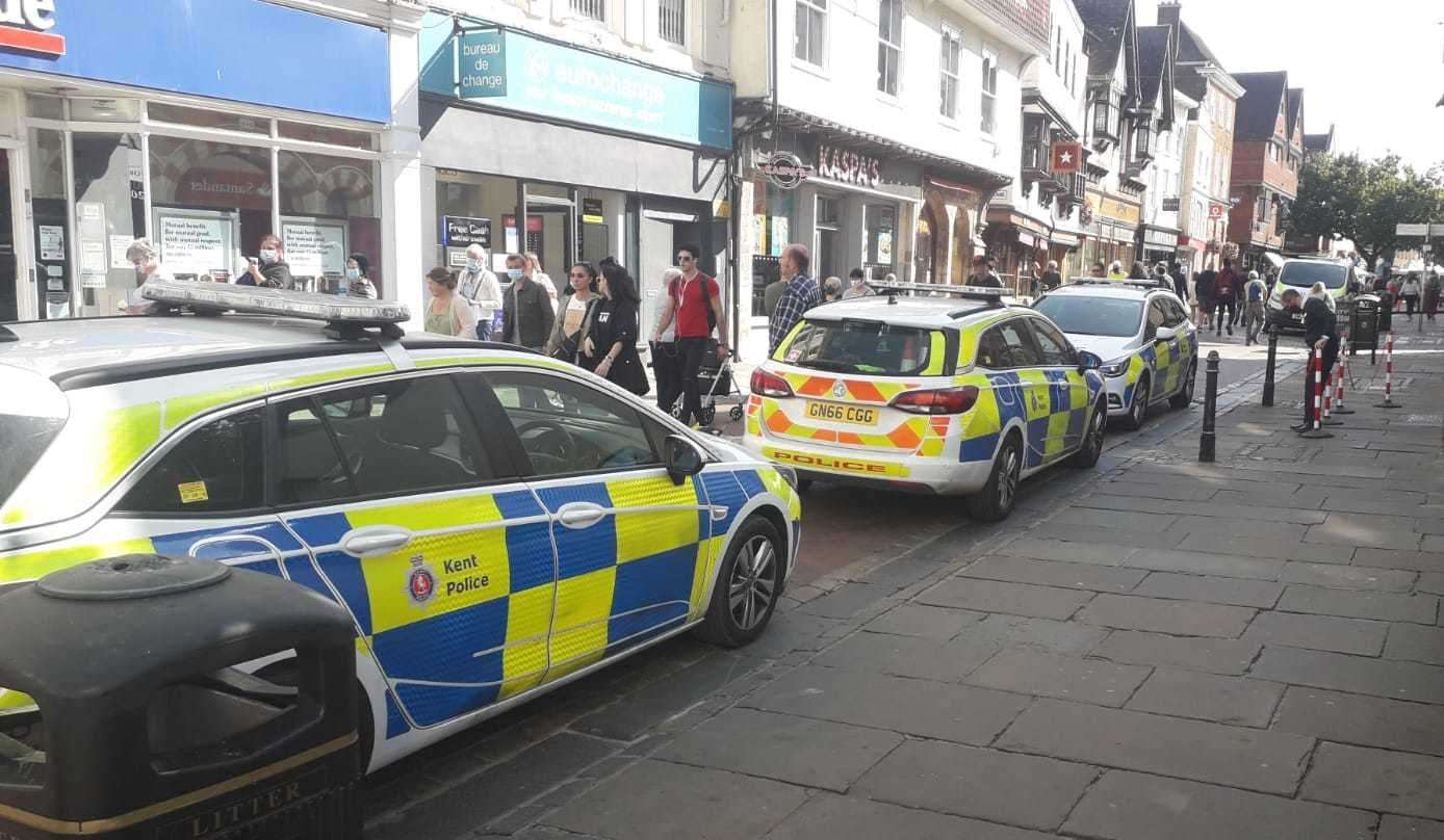 Three police cars and a police van have been spotted parked outside the Santander in the centre of Canterbury