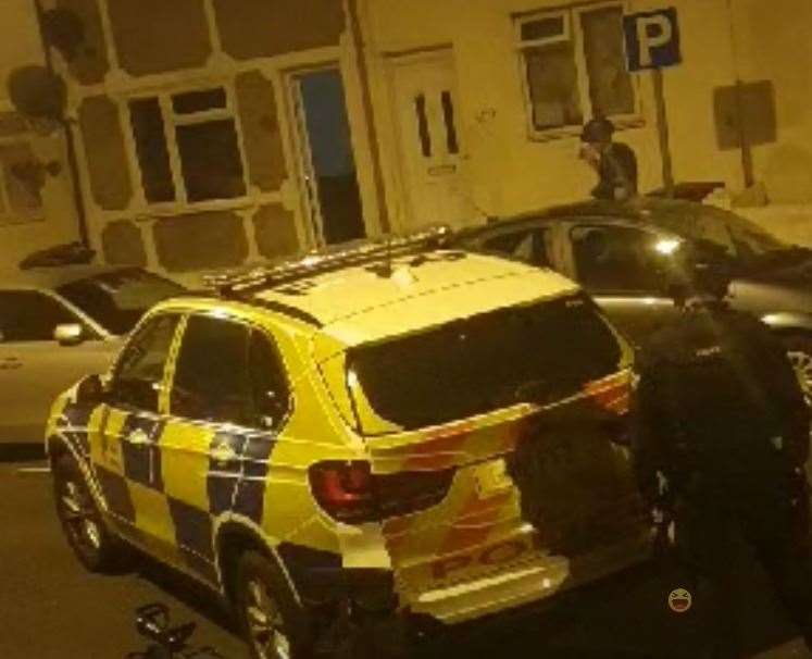 Police outside the property in Luton Road, Chatham, on Friday