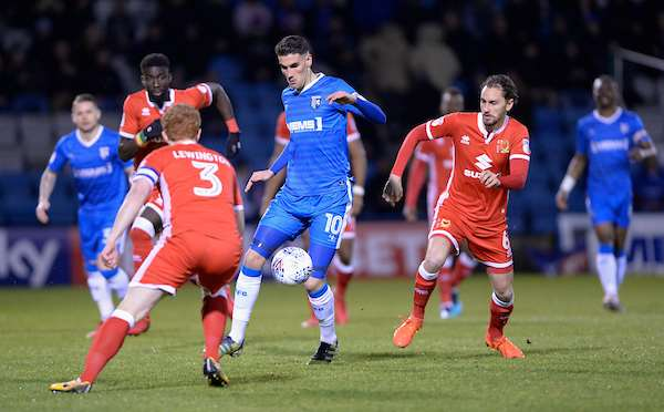 Gillingham's Conor Wilkinson against MK Dons' Dean Lewington and Ed Upson Picture: Ady Kerry (1341577)