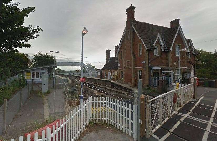 The men were escorted off at Wye Train Station. Picture: Google