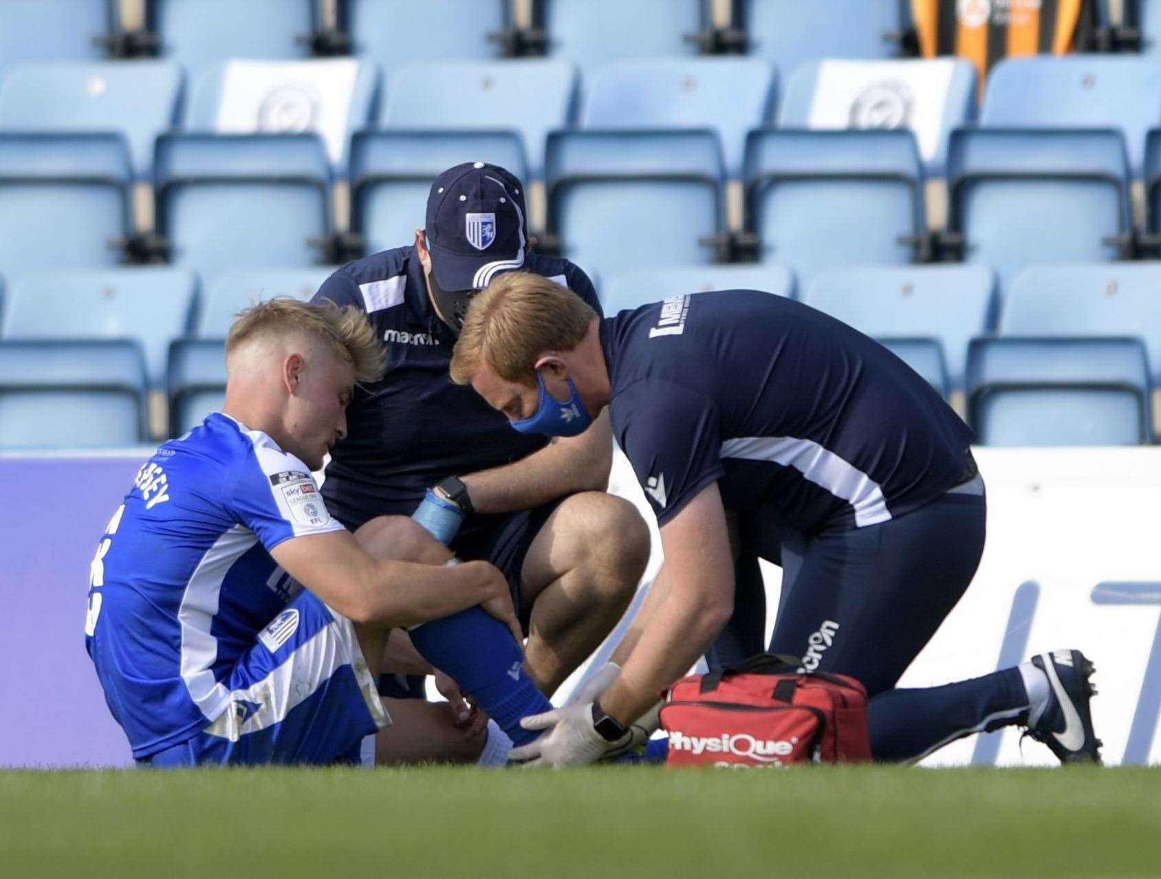 Kyle Dempsey receives treatment after suffering an ankle injury Picture: Barry Goodwin