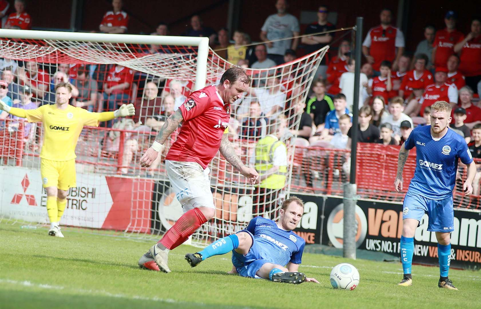 Danny Kedwell tries to get away from Stuart Lewis in the penalty area Picture: Phil Lee