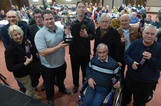 Phil Wilson, in grey top, from IMP presents the champions trophy to Supernova at the 2018 Big Quiz final (11802618)