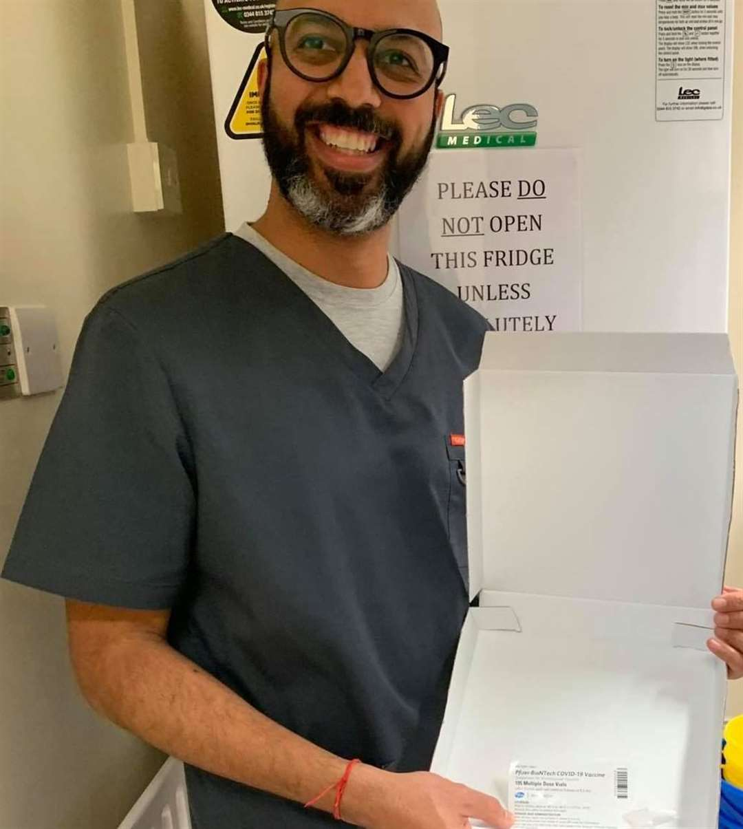 Dr Gaurav Gupta with the Pfizer/BioNTech vaccine. Picture: Faversham Medical Practice