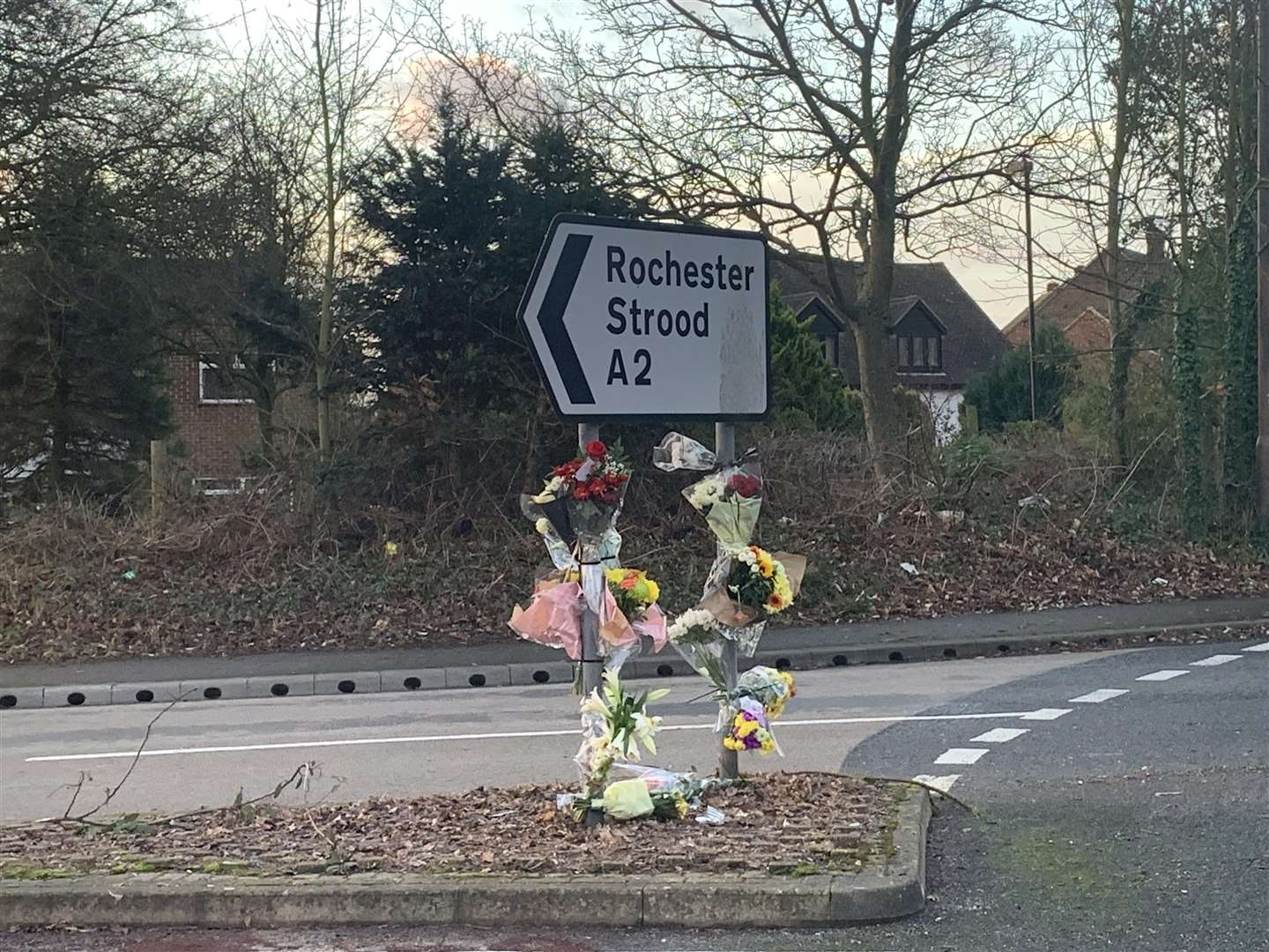 Flowers were attached to a sign by the Three Crutches roundabout