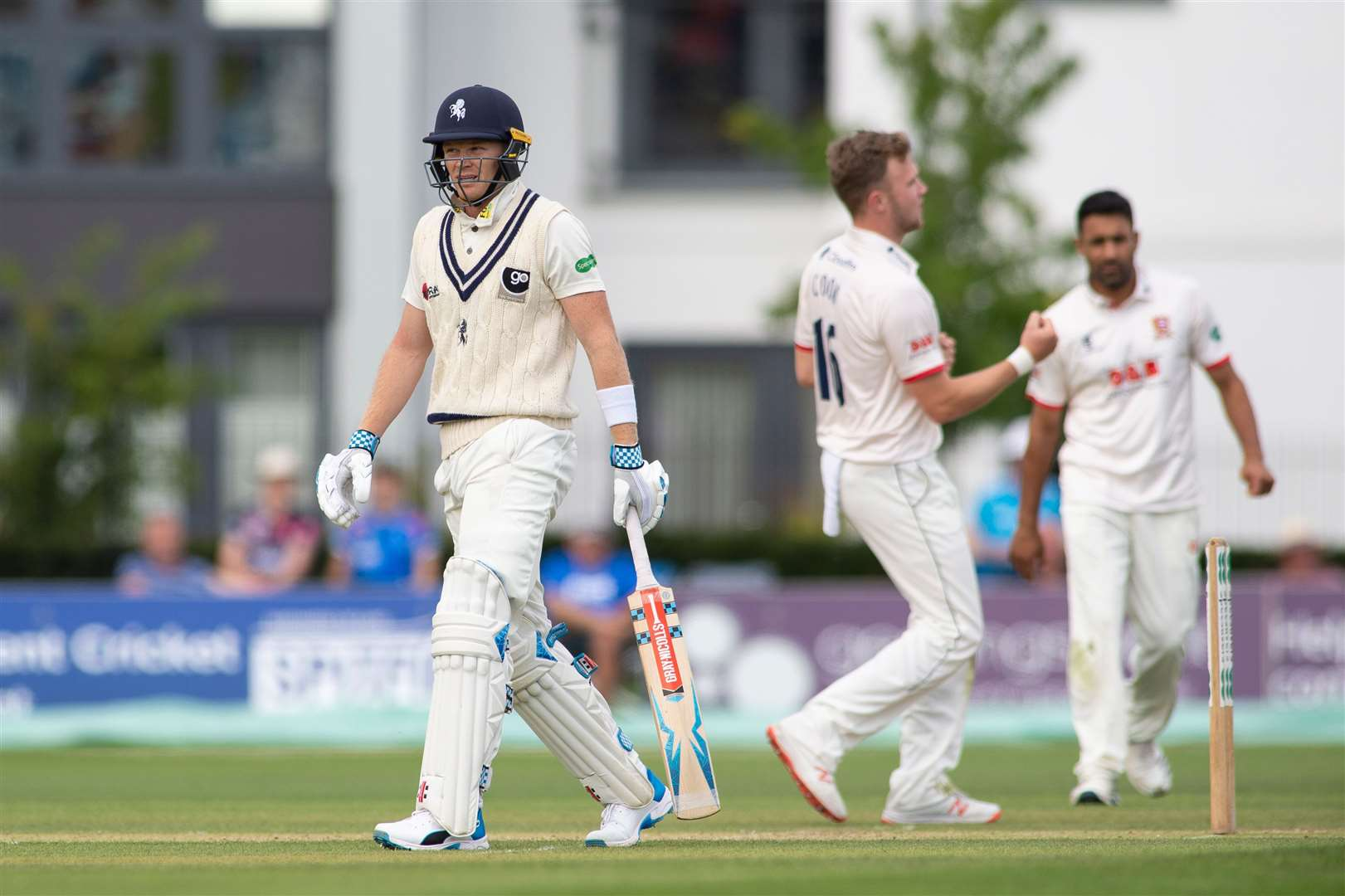 Kent's Sam Billings walks off after being beaten LBW to by Essex's Sam Cook. Picture: Ady Kerry
