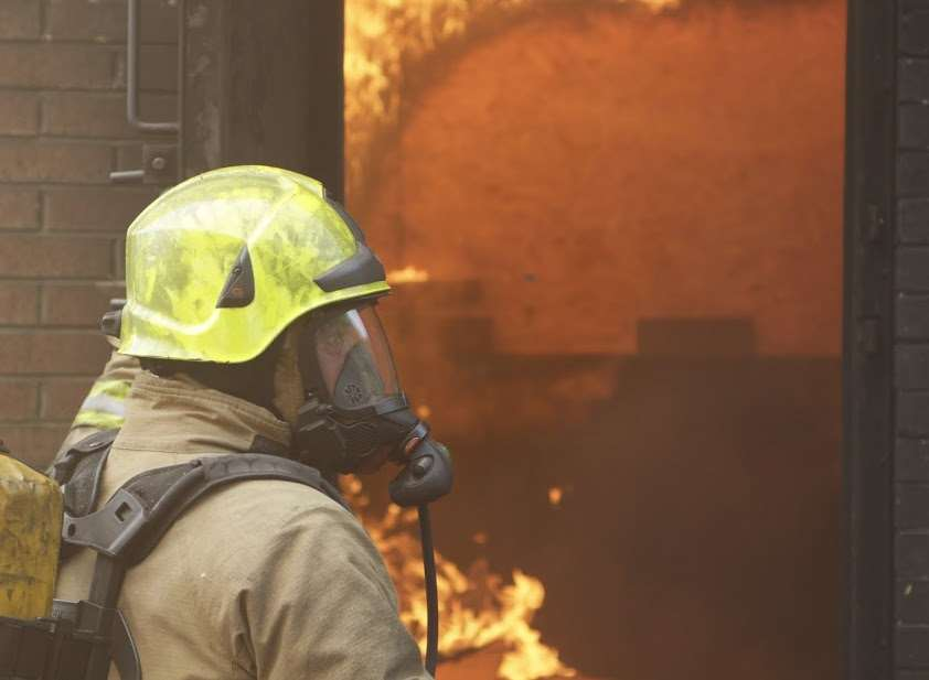 Firefighters wearing breathing apparatus tackled the blaze. Stock picture