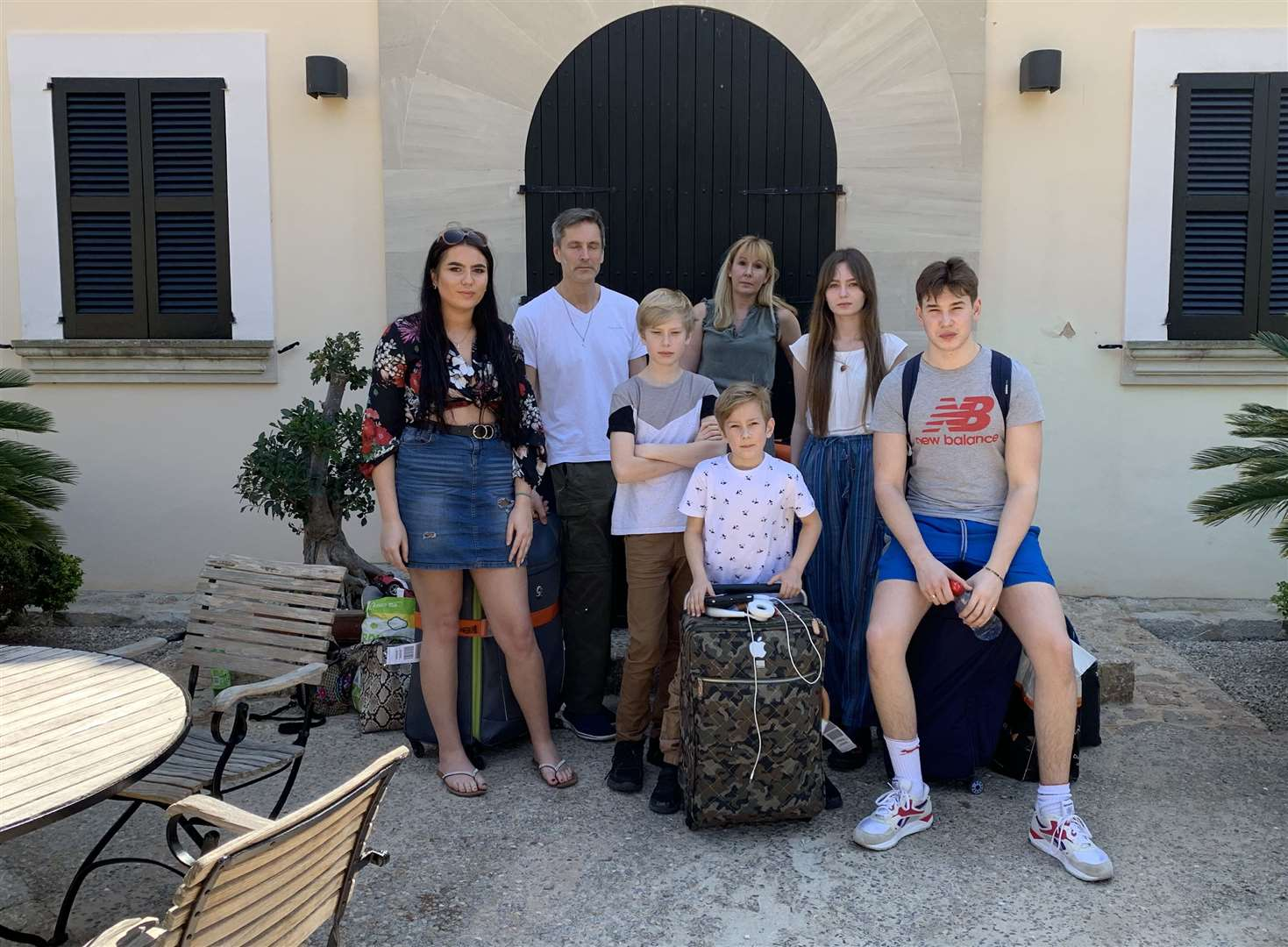 Angus Kennedy and his family outside the villa they expected to be renting
