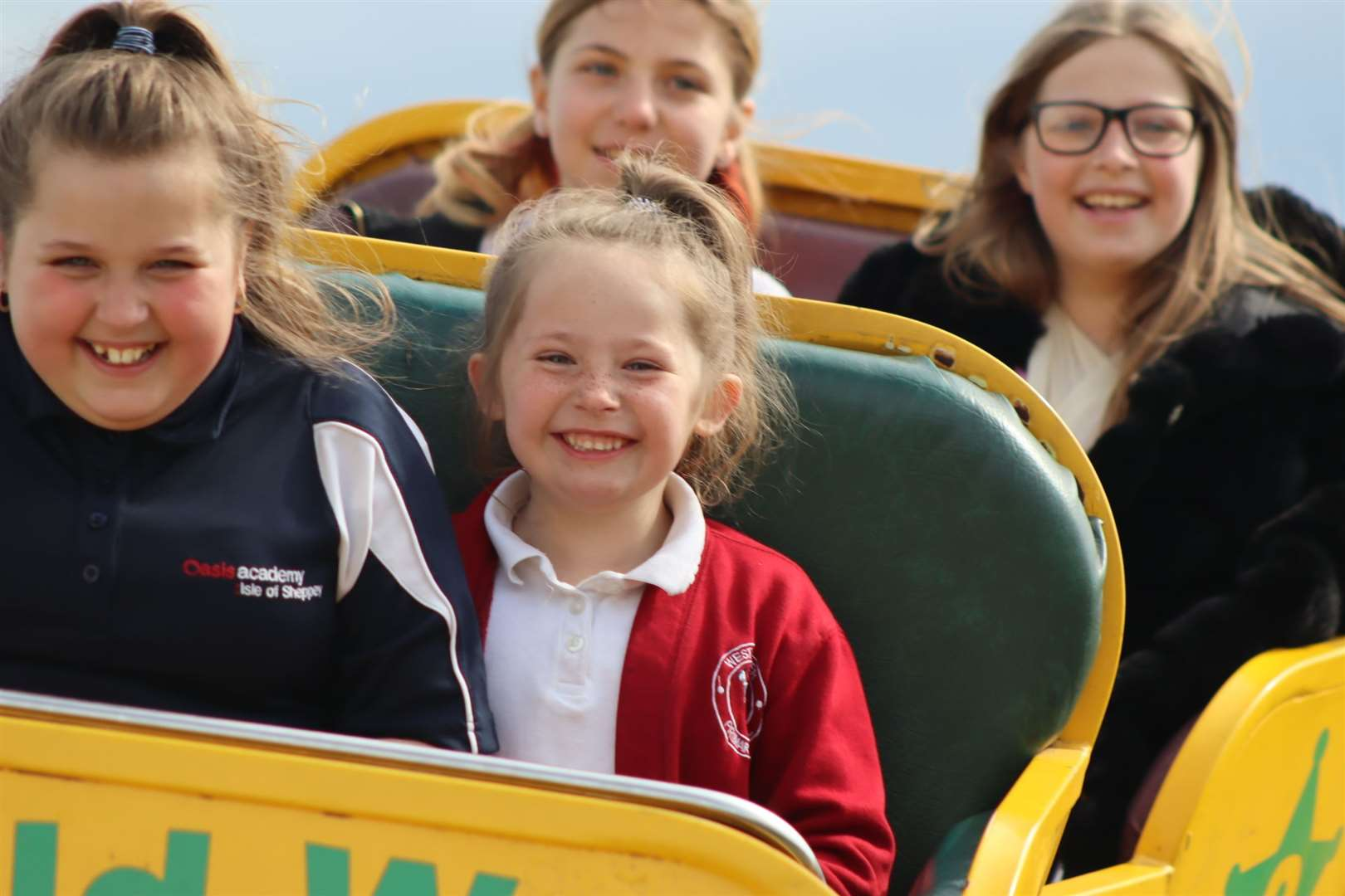 Girls riding the Wild West rollercoaster at Smith's funfair, Barton's Point, Sheerness