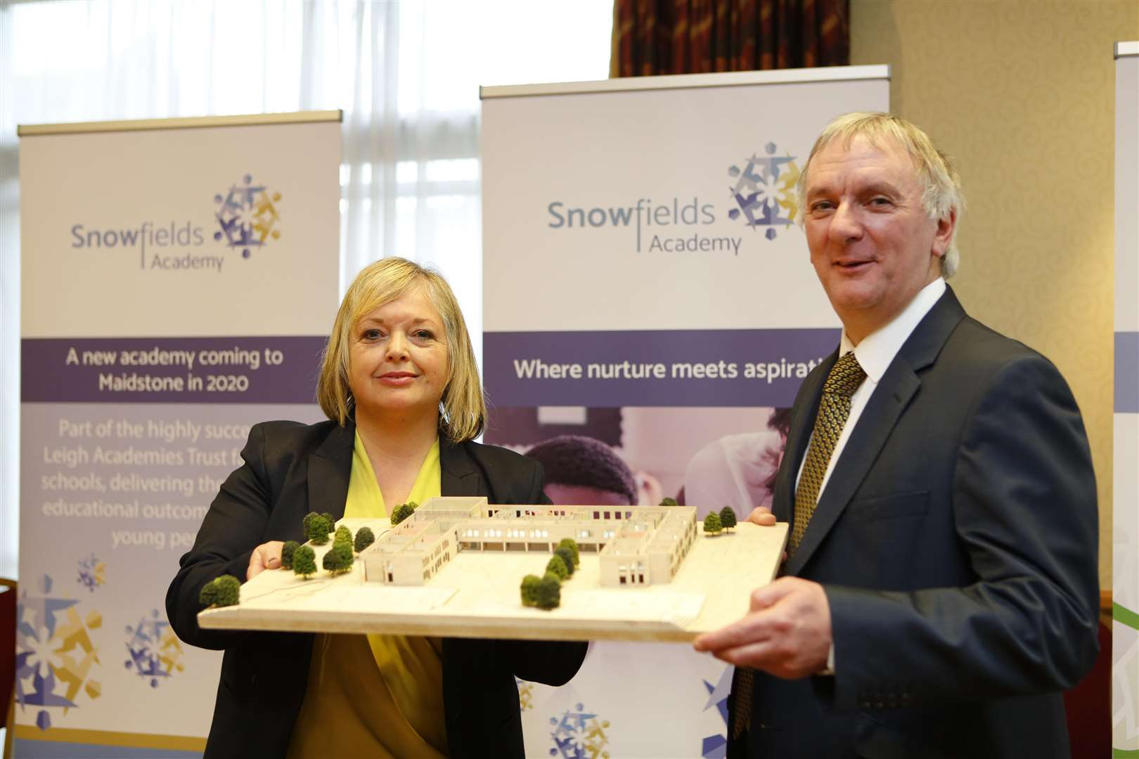 Dee Pickerill, the principal designate at Snowfields Academy, and Neil Willis, deputy CEO at Leigh Academies Trust with a model of the new schools