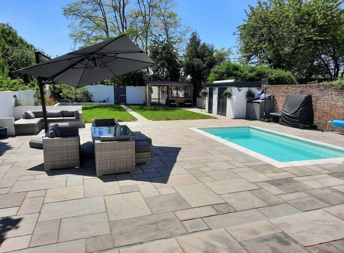 The south-facing rear garden with sunken heated pool. Picture: Zoopla / Machin Lane Partnership