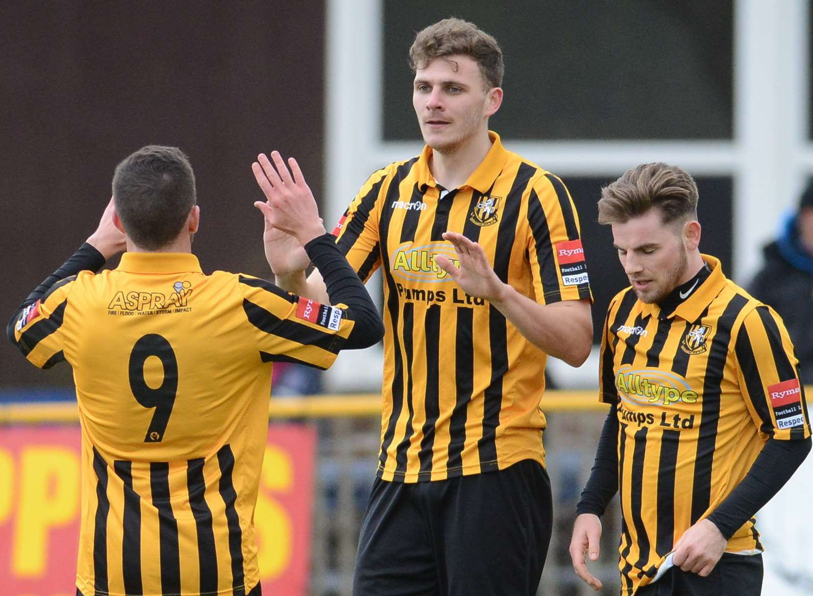 Harry Smith (centre) celebrates scoring for Folkestone Picture: Gary Browne