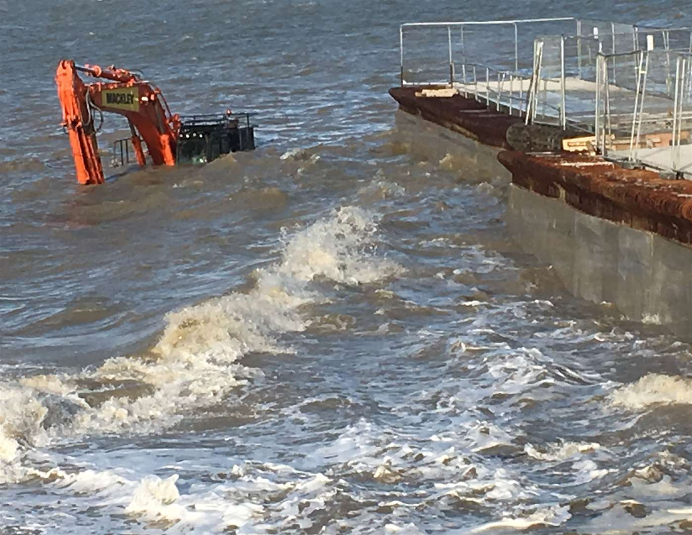 All at sea: the drowned digger at Neptune's Jetty, Sheerness. Picture: Wayne Featherstone (7801772)
