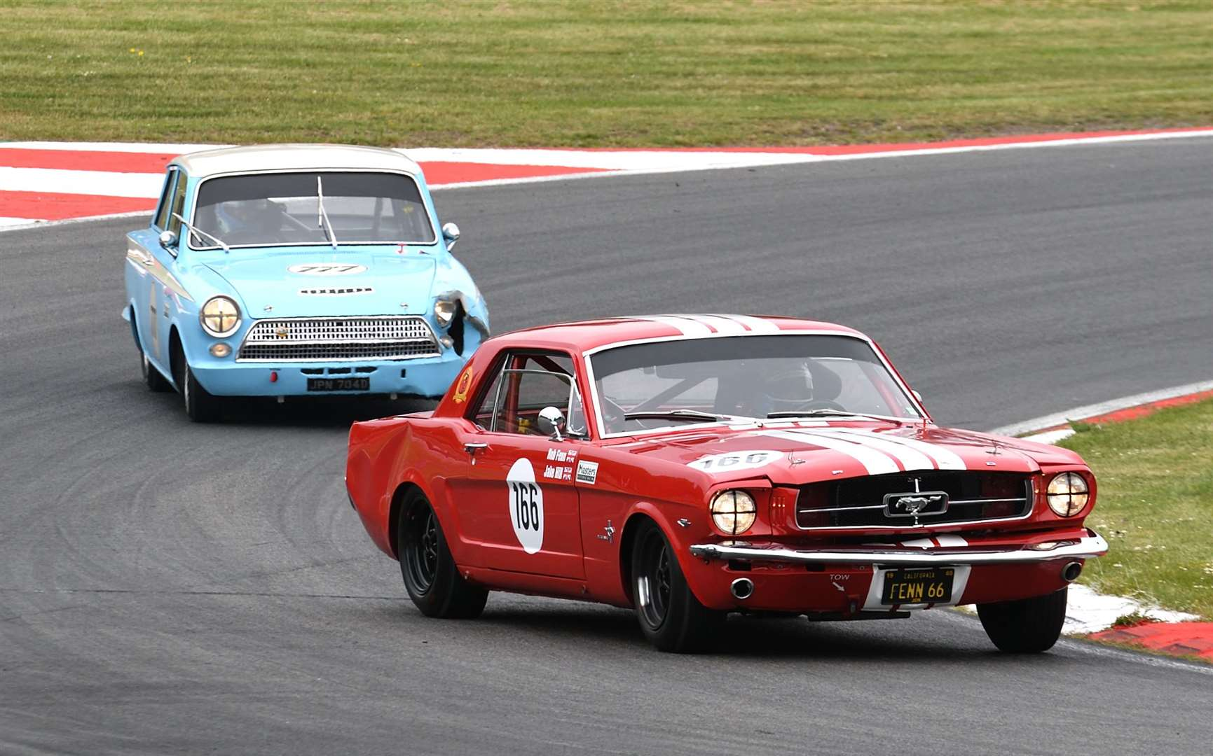 Hill - here racing a 1965 Ford Mustang in May 2019 - has been regularly testing historic cars this year. Picture: Simon Hildrew