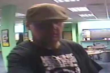 Do you recognise this man? Police want to identify him after a burglary at a bookmakers.