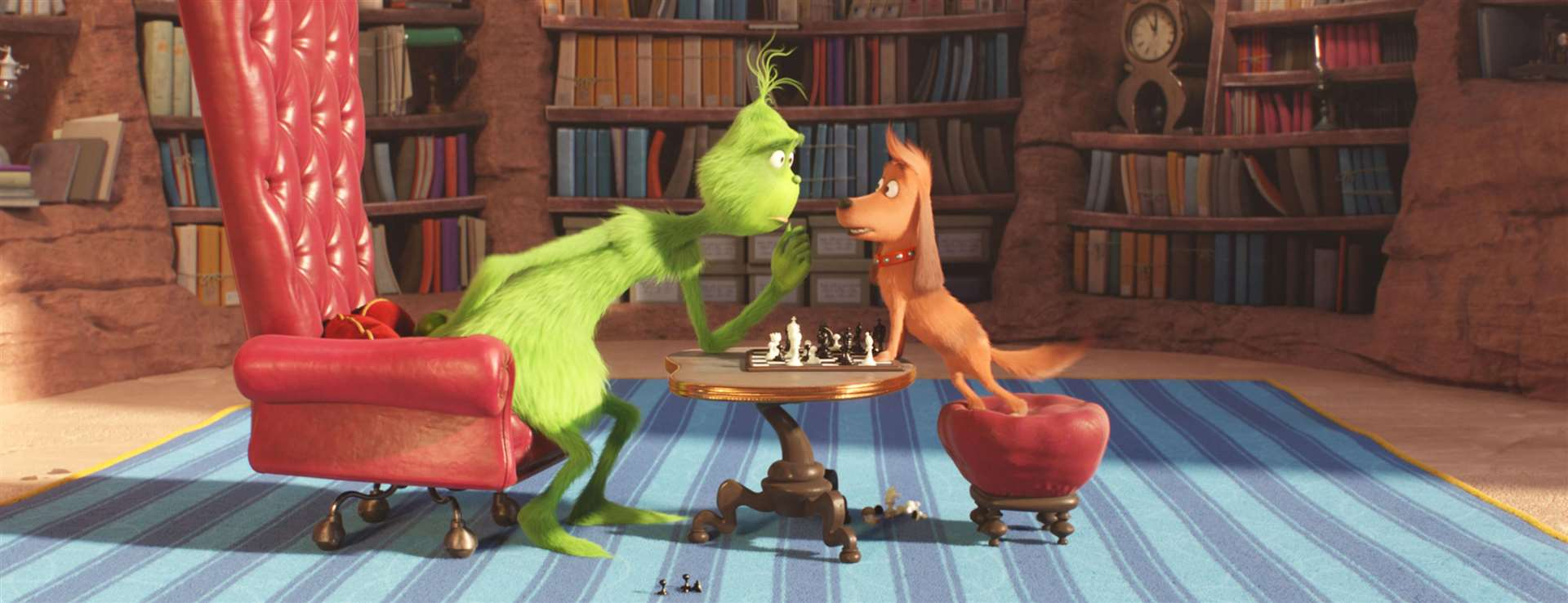 The Grinch (voiced by Benedict Cumberbatch) and trusty pooch Max play chess. Picture: PA Photo/Universal Pictures/Illumination/Dr Seuss Enterprises.