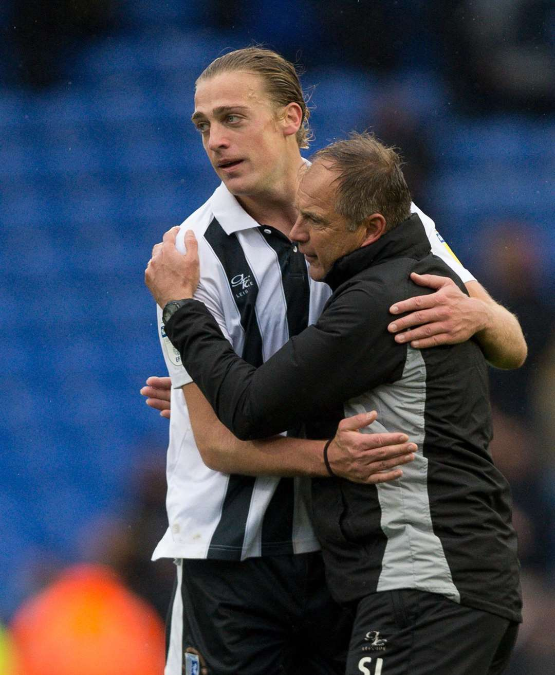 Tom Eaves celebrates with Gills boss Steve Lovell after the win at Pompey Picture: Ady Kerry