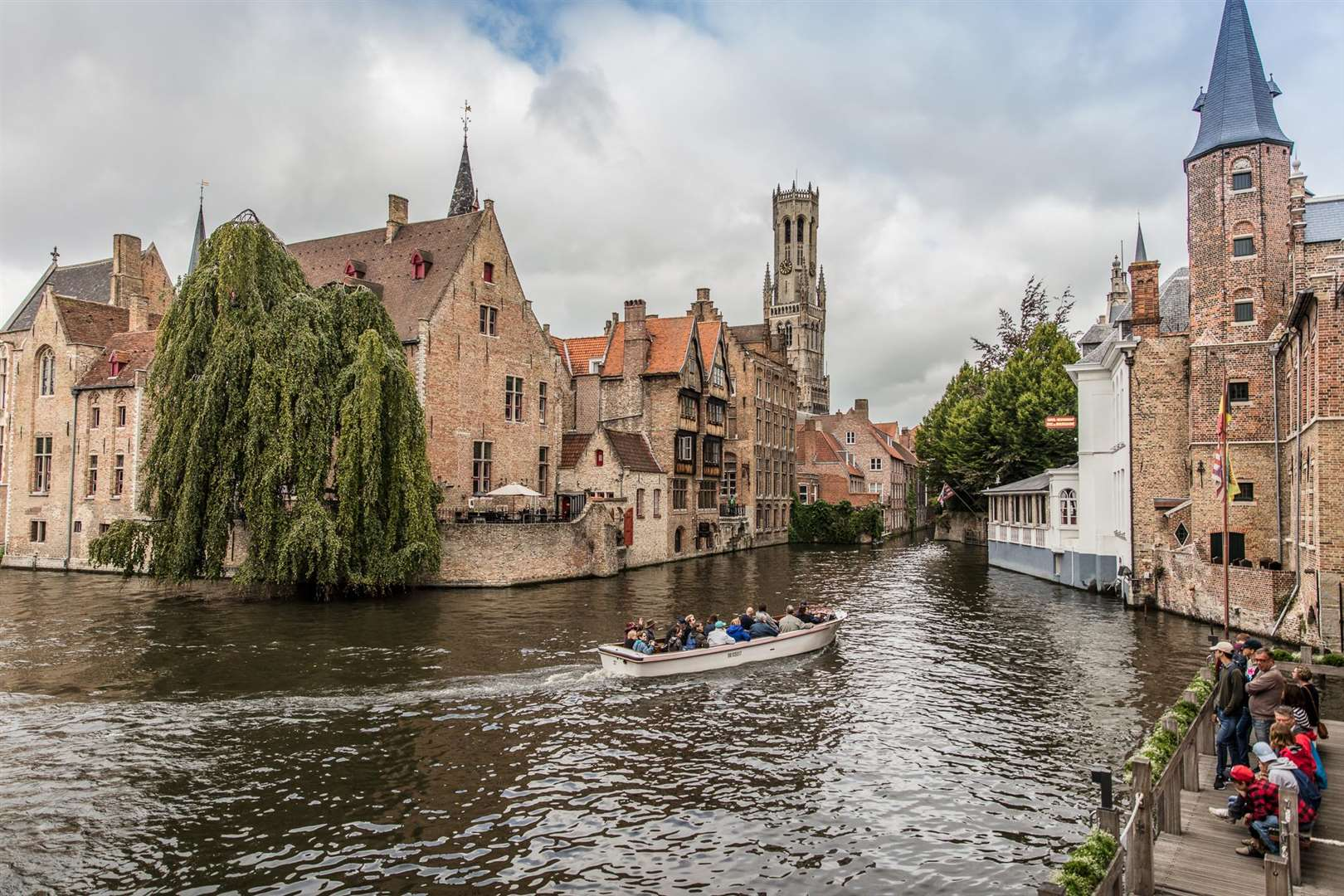 A boat trip on the canals is a must when visiting Bruges, credit, Pieter D'Hoop