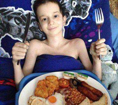 Reece Puddington enjoying a cooked breakfast in bed as part of his bucket list