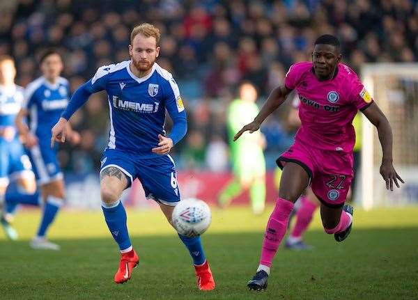Connor Ogilvie looks to get onto the loose ball before Kwadwo Baah during the meeting at Priestfield Picture: Ady Kerry