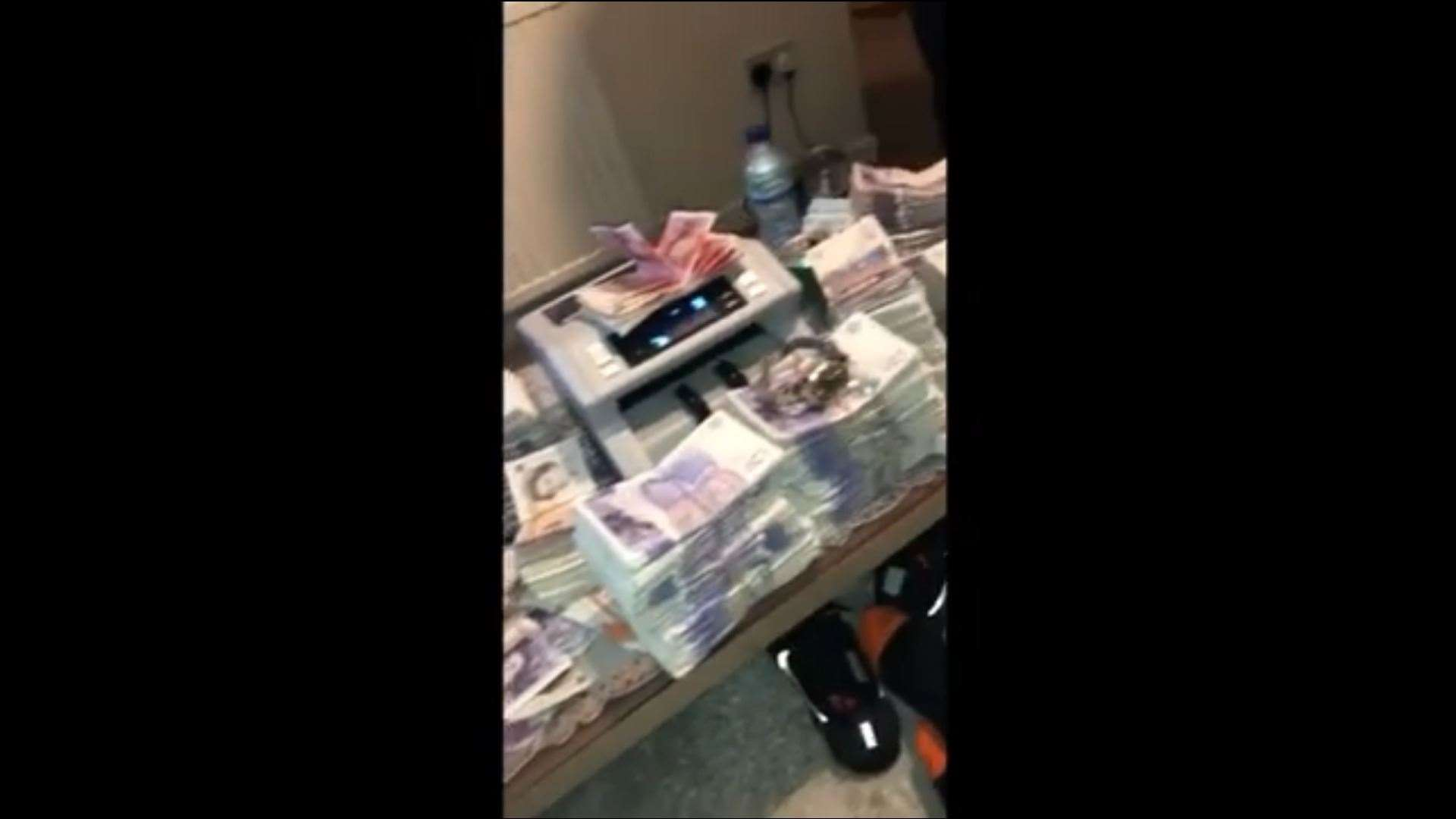 Money and a Rolex can be seen during the video (12213979)