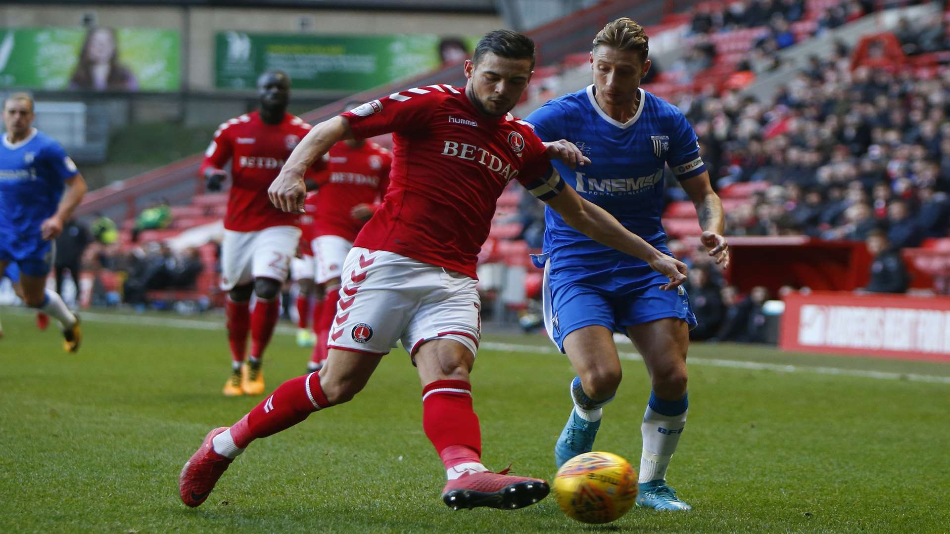 Gills skipper Lee Martin takes on Charlton's Jake Forster-Caskey Picture: Andy Jones
