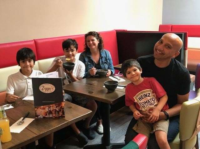 The Solanky family having lunch and ice cream