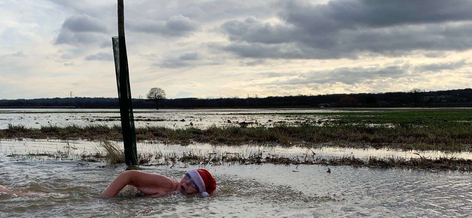 Jackie Cobell, a Capel resident, swam in flood water on Hartlake Road to highlight the flood risk