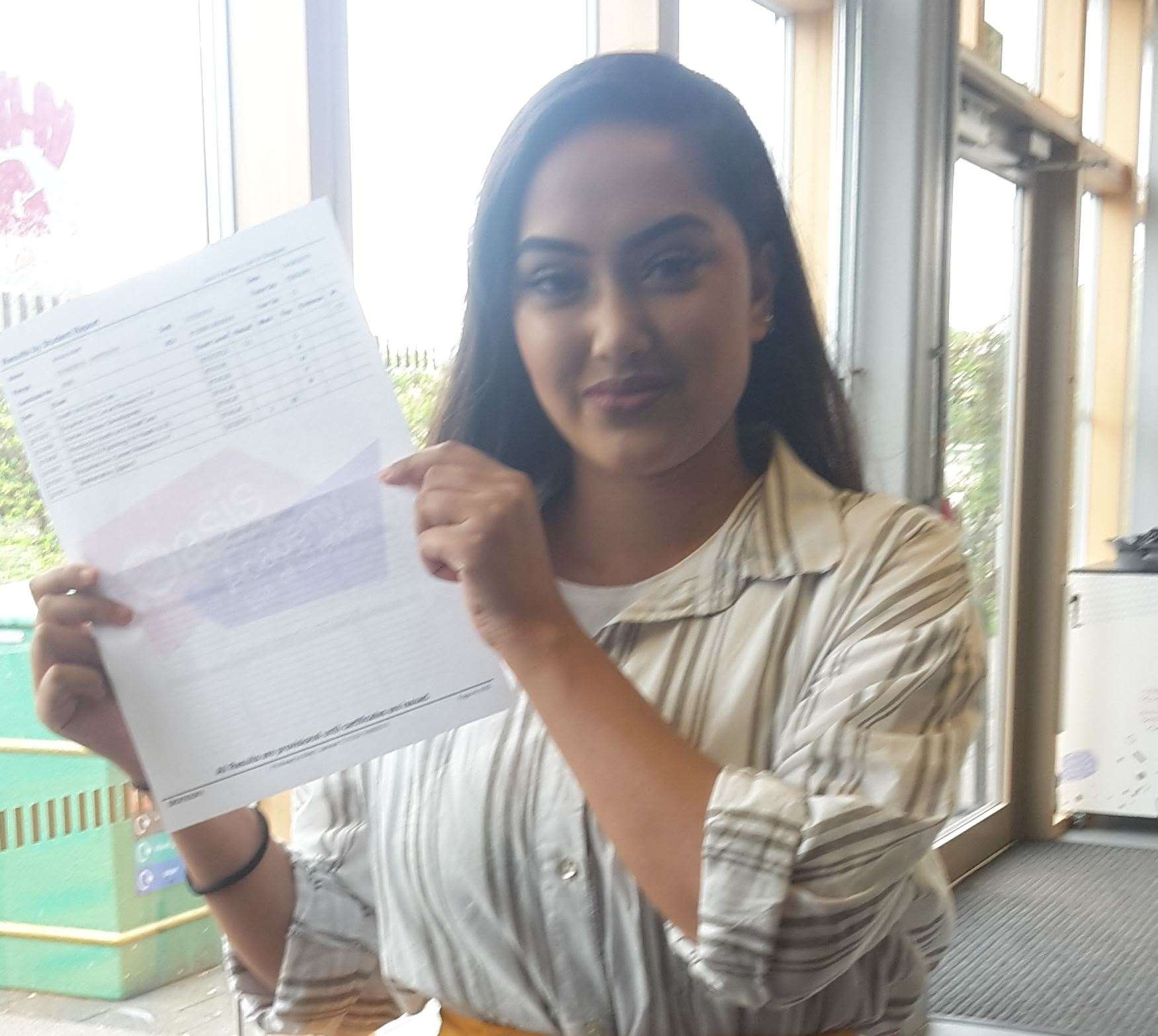 Oasis Academy student Anisa Islam, 18, with her A-level results